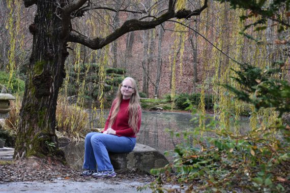 me sitting on a rock at Gibbs Gardens